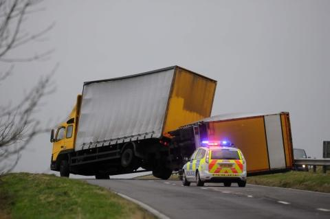 A lorry blown over by winds on the A35