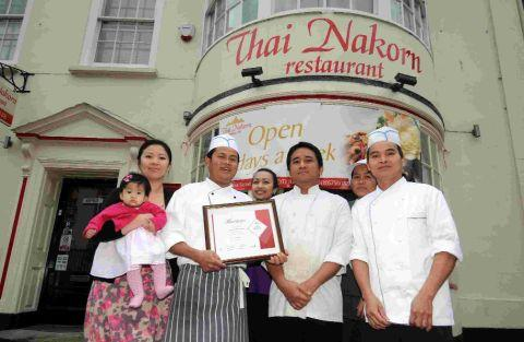 FOOD FOR THOUGHT: Staff at Dorchester's Thai Nakorn restaurant with the award