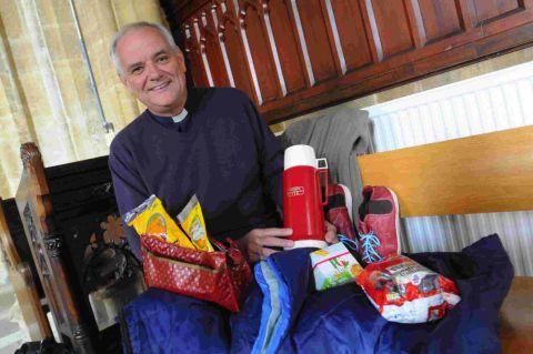 HERE TO HELP: The Rev Andrew Evans with some of the collected items for homeless people