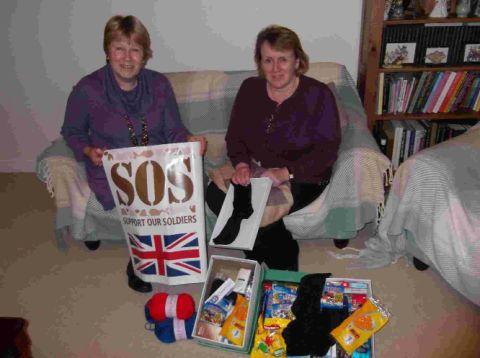 VOLUNTEERS: Gloria Ashwell and Amanda Saunders are appealing for donations of hats, scarves and gloves for troops