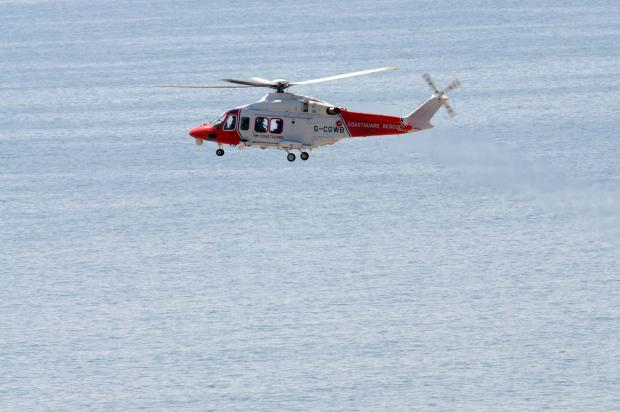 Man airlifted after going overboard at West Bay