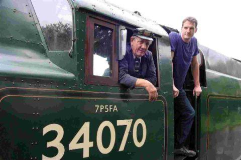 CHUFFED TO BITS: Driver Tony Hallworth and Dan Snow at the railway