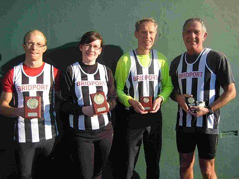 TOP TEAM: Bridport Runners, from left:  Ben Wilshaw, Vicki Ackerman and Norman Wiggins with Pete Blackmore
