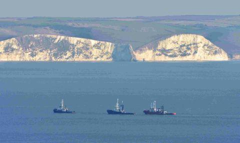 PULLED TO SAFETY: The stricken tug is towed around Portland and into Weymouth Bay