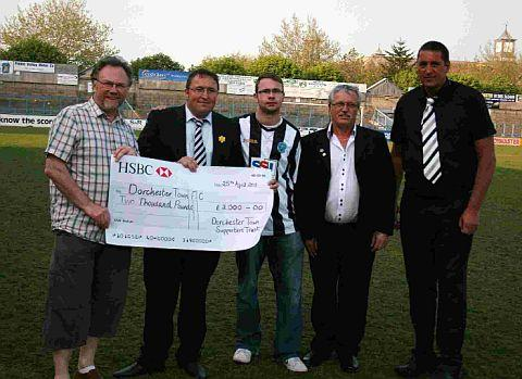 Dorset Echo: HISTORIC SUPPORT: Trust board members John Greenslade, Ash Jury and Dave Ring present club chairman Shaun Hearn and director Paul Harris with a cheque for £2,000 in 2011