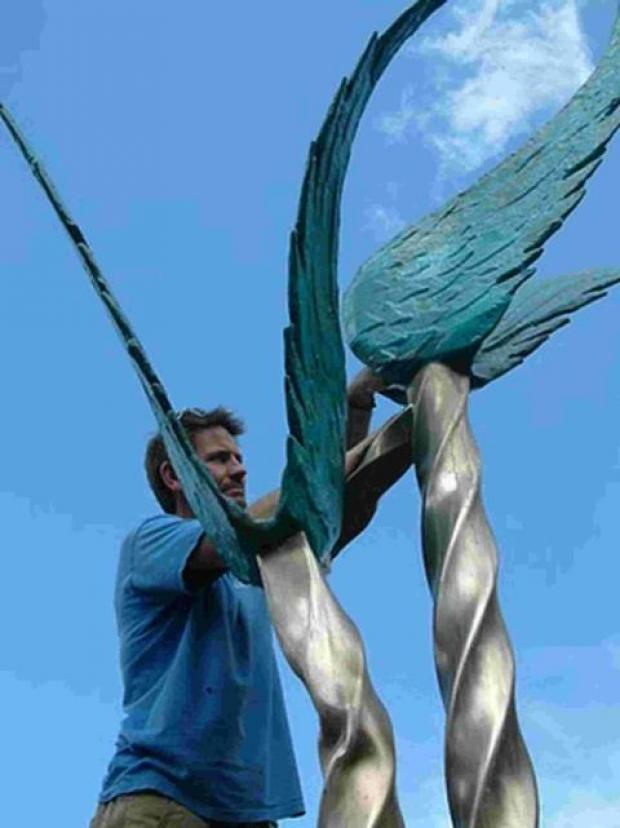 ARTIST AT WORK: Andy Kirkby working on one of his previous sculptures
