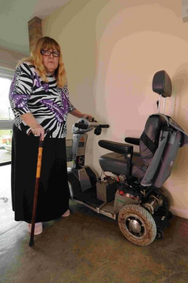 HOUSEBOUND: Disabled Janet Cole with her wrecked mobility scooter