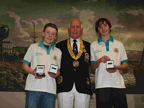 YOUNG STARS: Brandon King, left, and Ryan Nash, right, with David Eastman, President of Dorset Indoor Bowls Association