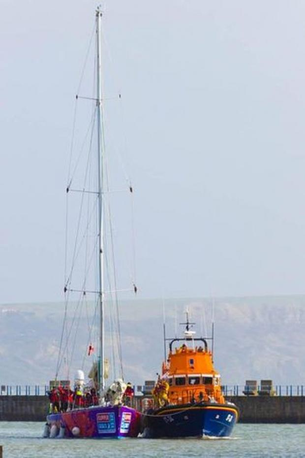 Weymouth lifeboat tows stricken yacht to safety