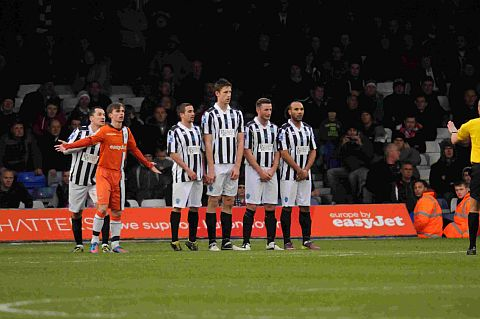 DORCHESTER WALL: The Magpies with Jamie Gleeson, second right, who has signed a two-year contract, defending a free-kick at Luton in the FA Cup