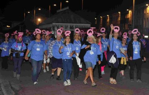 STRIDING OUT: Women take part in a previous Weldmar Midnight Walk along Weymouth seafront
