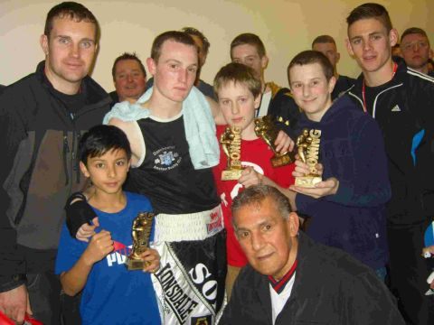 BOXING CLEVER: Dorchester boxers with their club coaches at the Poole show