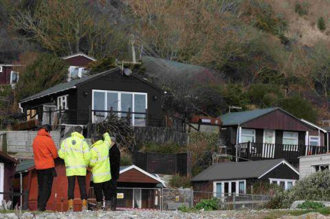 COMING DOWN: Some of the chalets facing demolition after the latest landslip at cliffs on Monmouth beach in Lyme Regis