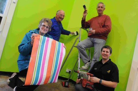 TAKING OVER: Decorating Charmouth Library. Above, volunteers Geoffrey Brierley, Mandy Harvey, Jane Clifford, David Clifford and Hazel Robinson outside the library