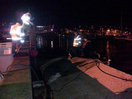 INSPECTION: Council staff check out one of the damaged pontoons