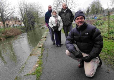 KICKING UP A STINK: Councillor David Taylor, front, with from left, Tony and Jacqueline Jacobs and Councillor Dave Roberts on the River Frome pathway