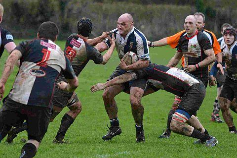 BRUTE STRENGTH: Bridport's Rob Sullivan is tackled by Ivel Barbarians