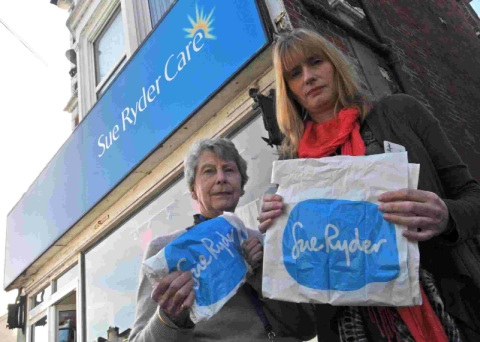CANNABIS SHOCK:  Sue Ryder store manager Samantha Osborne, right, with volunteer Pamela Pittman