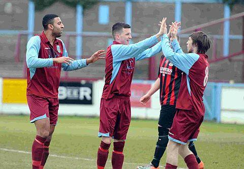 TERRAS' OPENER: Sean Zima, centre, celebrates after scoring Weymouth's first