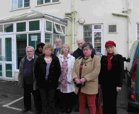 NOT HAPPY: Town councillors and protestors outside the Bridport Foyer at West Rivers House after news of its proposed closure