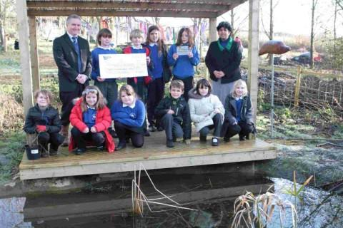 THANKS A LOT: Youngsters at Thorners School celebrate the Watermark Award at the dipping pond