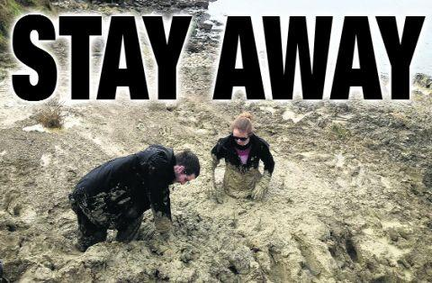 GOING NOWHERE: Two people stuck in the mud at Lulworth