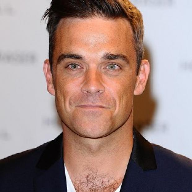 Dorset Echo: Robbie Williams has been in the studio with Guy Chambers