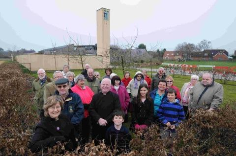PRAISE BE: Rector Jacquie Birdseye, left, and members of the congregation on the site of the new church in Crossways