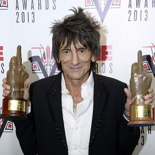 Ronnie Wood with the awards for Best Music Film and Music Moment of the Year at the NME awards