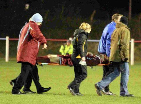 OUT FOR REST OF SEASON: Weymouth ace Kyle Critchell is stretchered off with a leg injury at the County Ground