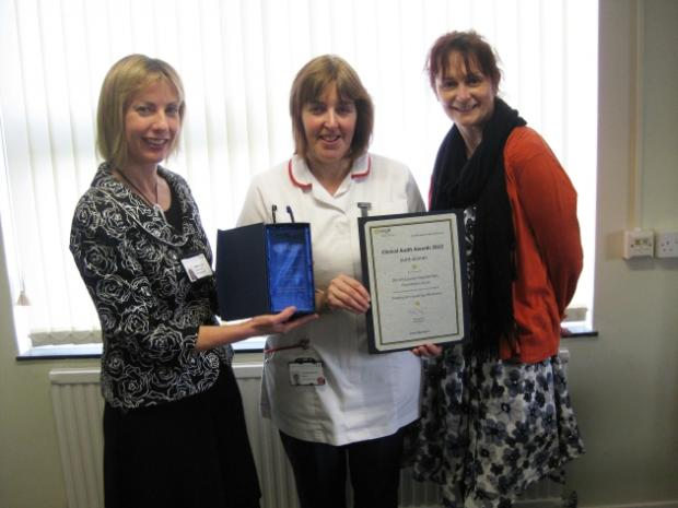 Linda Woodsford (centre) receives her award