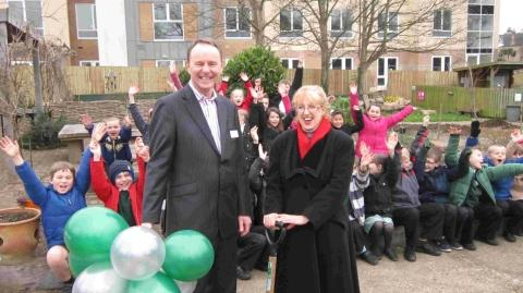 SHOW OF HANDS: Peter Curtis and Helen Toft with pupils in the garden