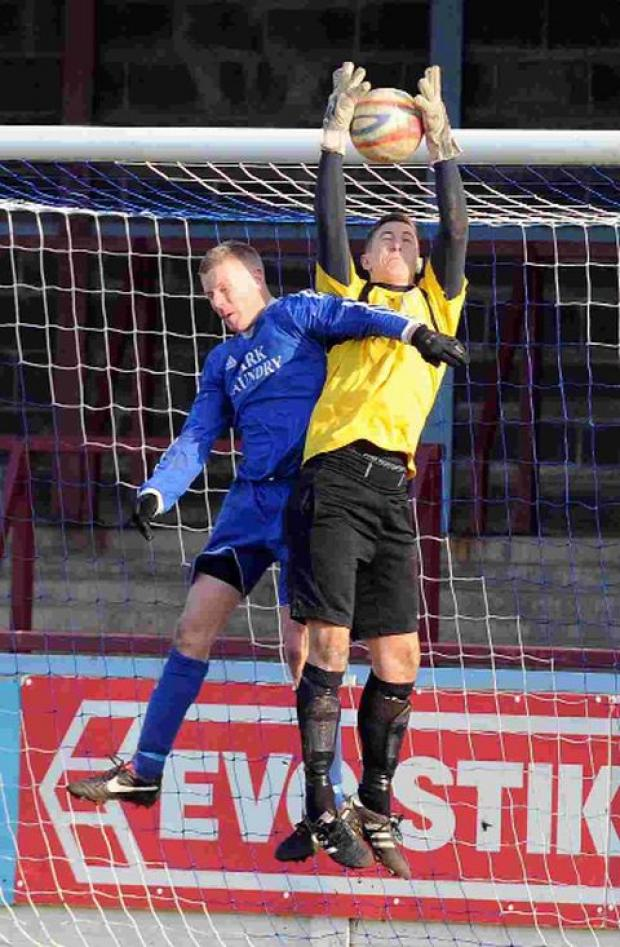 TURNING POINT: Adam Linaker challenges Terras' keeper Chris Povall