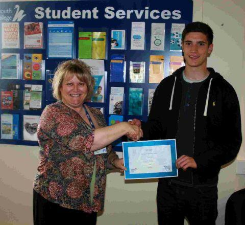 VALUABLE LESSON: Lloyd Beals who won a prize at last year's Barclays Money Skills Week is presented with his award by Sue Dafter