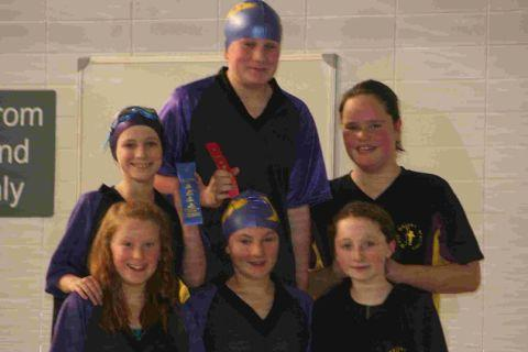 CAP THAT: Steps Four swimmers, from left, Phoebe Kelman-Johns, Maddy Johnson, Chloe Hedges, Grace Sheehy, Charly Wyatt and Alice Cullinane