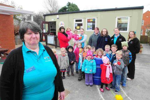 HUNT FOR HOME: Rosie Sharp with staff and pupils at Allsorts Pre-school who are to lose their building