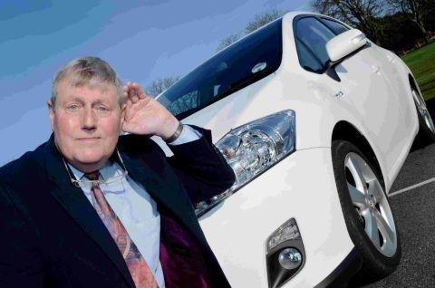 'ERE WE GO: John Andrews, Chairman of Dorset Blind Assocation with a hybrid car