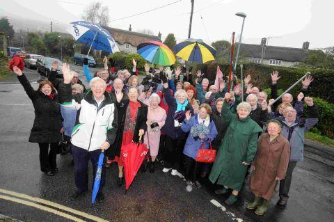 CHEERS: Sutton Poyntz residents celebrate the decision to keep their bus, Ian Bruce, front left