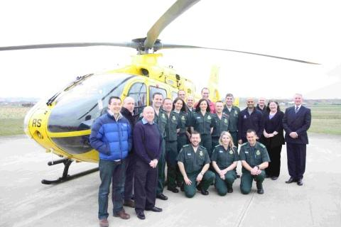 MOMENTOUS: Paramedics, university and air ambulance staff take a quick break during their first day of education and training
