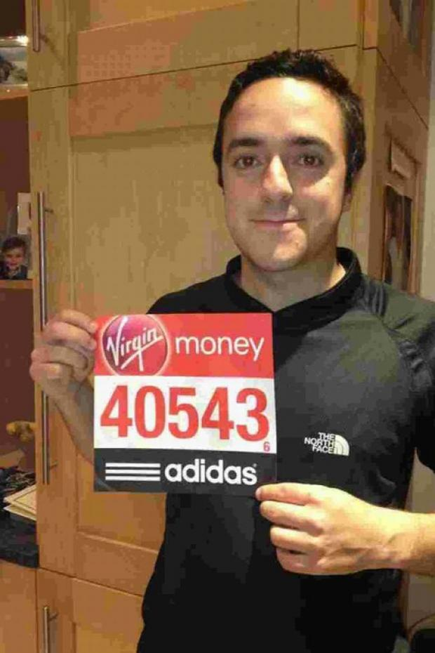 YOU MUST BE JOKING: Afsheen Panjalizadeh with his London Marathon number