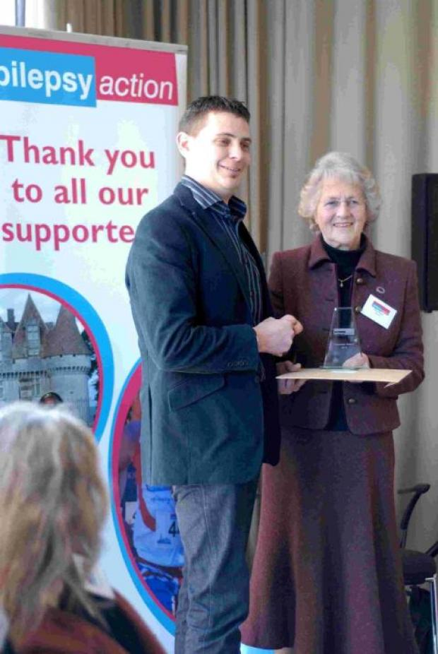 Dorset Echo: WELL DESERVED: Alec Hodgson receives his volunteer of the year award from Epilepsy Action trustee Beryl Sharlot