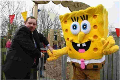 PLAY TIME: Parish councillor Robin Pitcher and special celebrity guest Spongebob Squarepants open the new Bere Regis play area