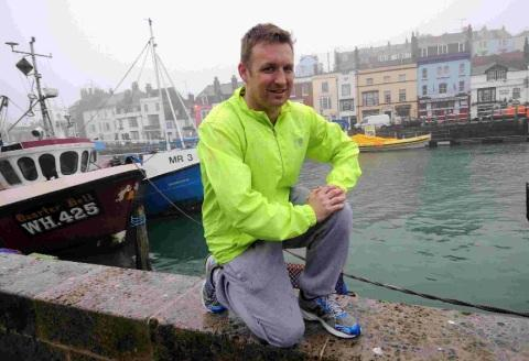 GOOD CAUSE: London marathon runner Nathan Wood is running in memory of his father-in-law and nan who both died of cancer