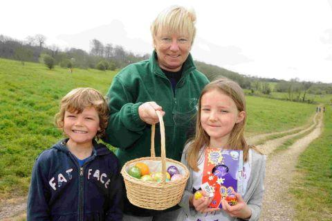 LOOK WHAT WE FOUND: Sue Liddell with Callum and Eloise Pearce at last year's Easter Egg Hunt