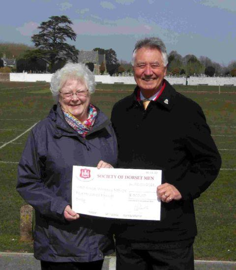 KIND GIFT: Andrew Prowse presents the cheque to Molly Rennie, chairman of the West Dorset Womens Refuge