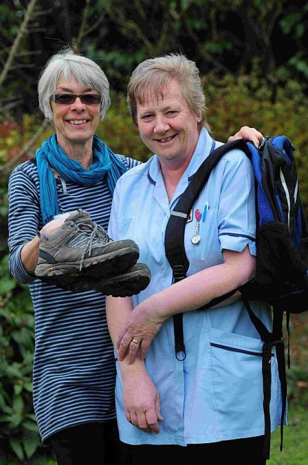 Dorset Echo: BOOTING UP: Weldmar nurses Jane Hargreaves, left, and Julia Miles are to take annual leave and walk the Dorset coast path to help raise funds for the trust