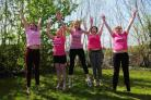 JUMP FOR JOY: Dorset Echo Race For Life team from left, Ruth Hayes, Emma Walker, Jo Davis, Catherine Bolado and Rachel Stretton
