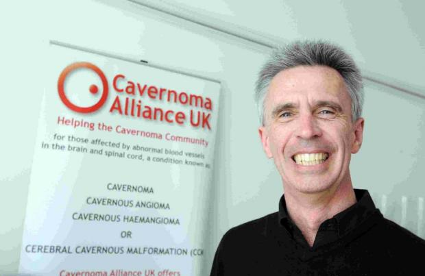 ALL SMILES: Dr Ian Stuart of the Cavernoma Alliance UK, which has just rec