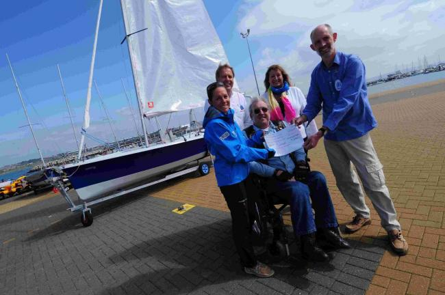 GIFT: Chesil Sailability recieve a cheque for £1,500. From left, Helena Lucas, John Tweed, Ian White, Jane Buckle and Hugh De Longh, chairman