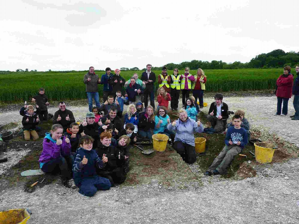 ACE OF SPADES: Young Archaeologists Club members with Bournemouth University staff and st
